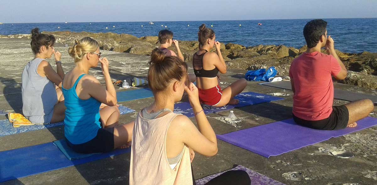 Yoga on the beach in Andalusia.
